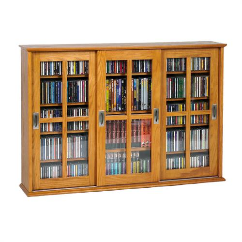 View a large image of the Leslie Dame Wall Hanging Mission Style Sliding Door Media Cabinet Oak MS-525-OAK here.